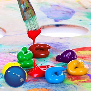 colorful oil paints and paintbrush - with Hawaii icon
