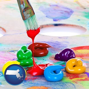 colorful oil paints and paintbrush - with Massachusetts icon