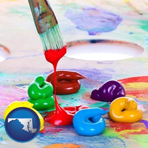 colorful oil paints and paintbrush - with Maryland icon
