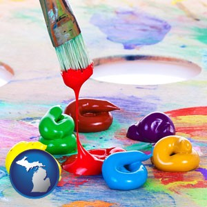 colorful oil paints and paintbrush - with Michigan icon