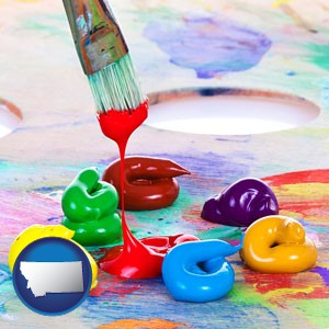 colorful oil paints and paintbrush - with Montana icon