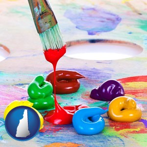 colorful oil paints and paintbrush - with New Hampshire icon