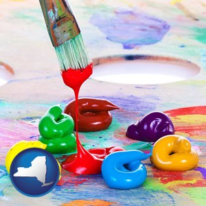 colorful oil paints and paintbrush - with New York icon