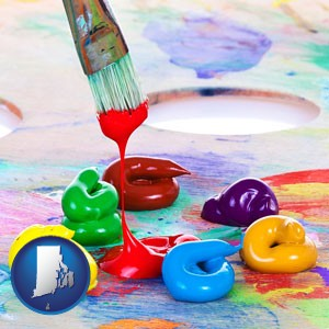 colorful oil paints and paintbrush - with Rhode Island icon