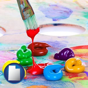 colorful oil paints and paintbrush - with Utah icon