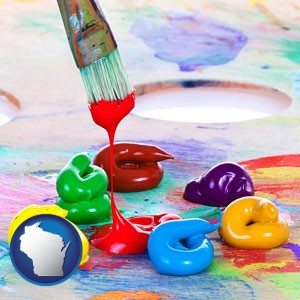 colorful oil paints and paintbrush - with Wisconsin icon