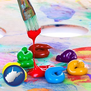 colorful oil paints and paintbrush - with West Virginia icon