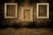 three gilded picture frames