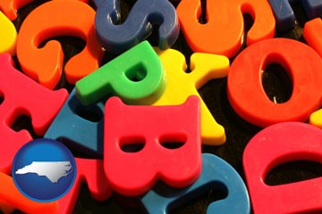 colorful plastic letters - with North Carolina icon