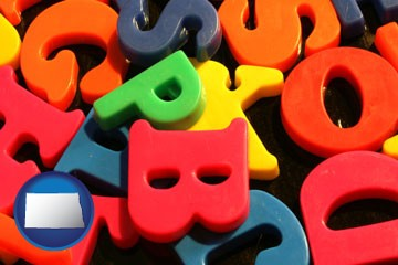 colorful plastic letters - with North Dakota icon