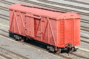 a box car in a railroad freight yard