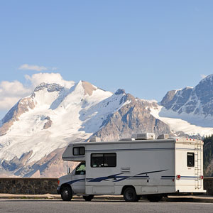 a recreational camper vehicle with mountain glacier background