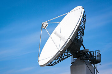 a satellite dish on an office building roof