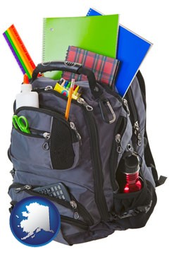 a backpack filled with school supplies - with Alaska icon