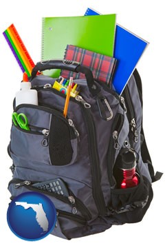 a backpack filled with school supplies - with Florida icon