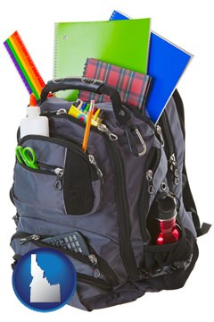 a backpack filled with school supplies - with Idaho icon