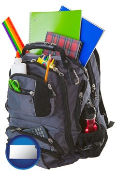 a backpack filled with school supplies - with Kansas icon