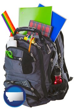 a backpack filled with school supplies - with Montana icon