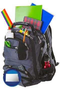 a backpack filled with school supplies - with North Dakota icon