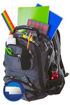 a backpack filled with school supplies - with Nebraska icon