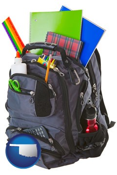 a backpack filled with school supplies - with Oklahoma icon