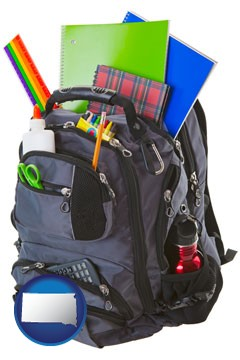 a backpack filled with school supplies - with South Dakota icon