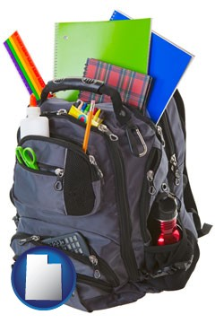 a backpack filled with school supplies - with Utah icon