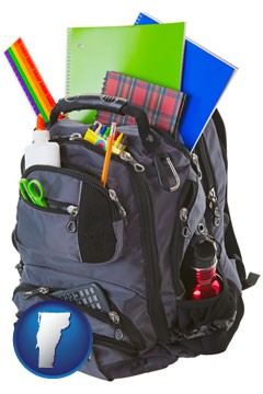 a backpack filled with school supplies - with Vermont icon