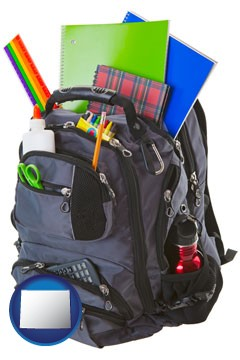 a backpack filled with school supplies - with Wyoming icon