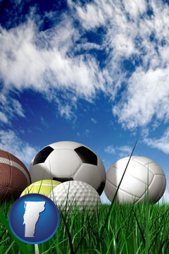 a football, a golf ball, a soccer ball, a tennis ball, and a volleyball - with Vermont icon
