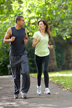 sportswear-attired joggers in a park