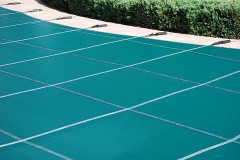 a teal swimming pool cover