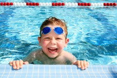 a boy in a swimming pool