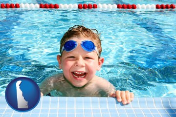 a boy in a swimming pool - with Delaware icon