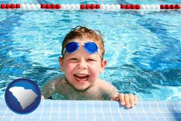 a boy in a swimming pool - with South Carolina icon