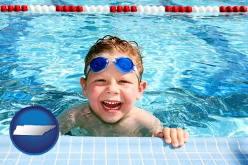 a boy in a swimming pool - with Tennessee icon