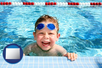 a boy in a swimming pool - with Wyoming icon