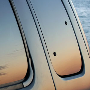 a sunset reflected in tinted glass car windows