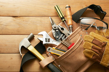 tools in a leather tool belt