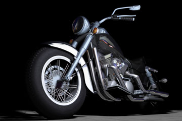 a vintage motorcycle on a black background