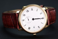 a classic wristwatch with leather watchband