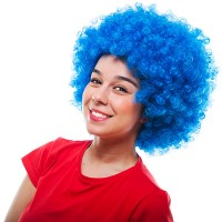 a smiling girl wearing a curly blue wig